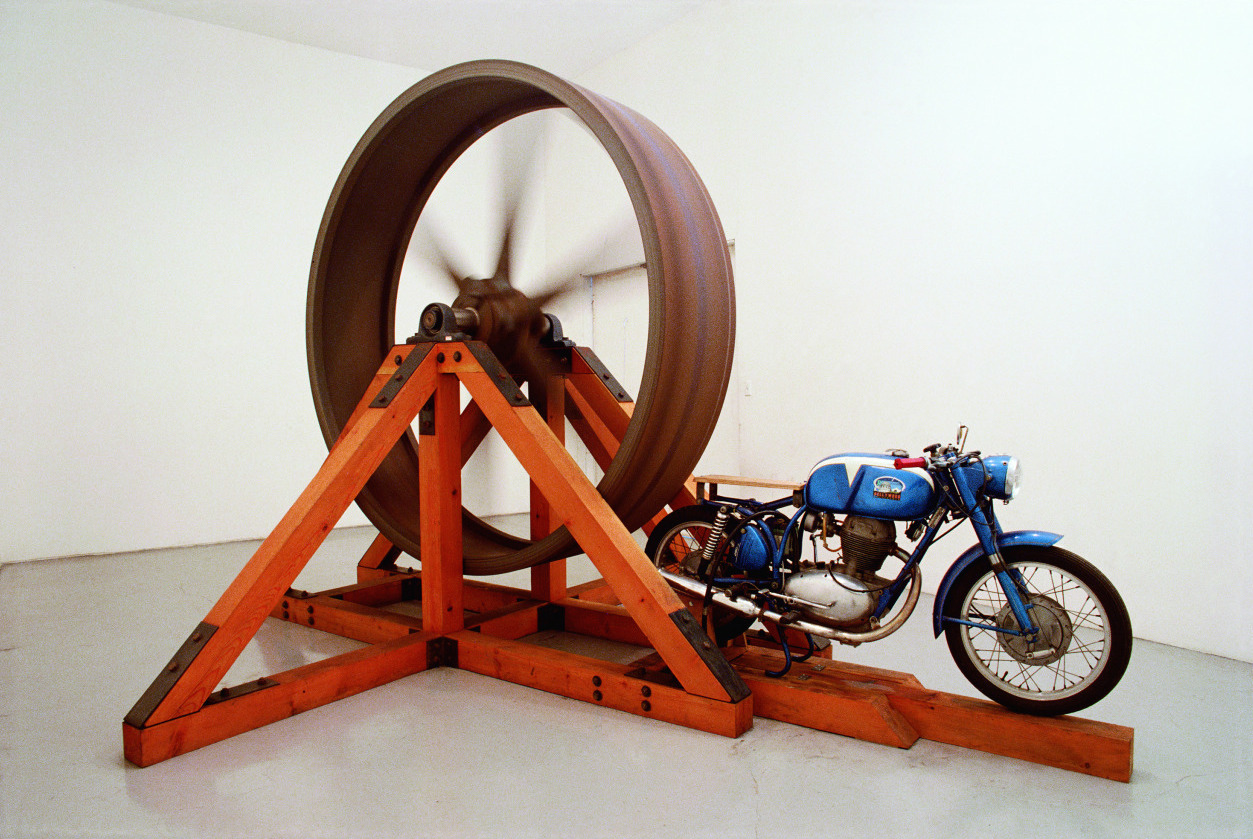 Chris Burden, The Big Wheel, 1979. 3-ton, 8-foot diameter cast iron flywheel powered by a 1968 Benelli 250cc motorcycle.