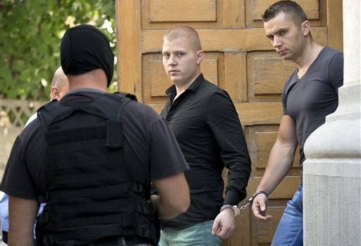 Eugen Darie and Radu Dogaru, debonair performance artists in their own right. Now behind bars.