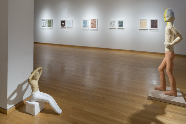 (left) Ruby Neri, Untitled (seated figure), 2014. ceramic, plaster and glaze. 28 x 23 x 17 inches. (right) Ruby Neri, Walking Man (yellow face), 2014. ceramic, plaster, glaze and paint. 70 x 11 x 14 inches. Courtesy of Stephen Wirtz Gallery.
