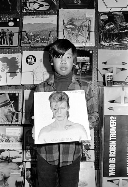 Michael Jang Chris in Record Store, from the series The Jangs, 1973 Gelatin silver print 11 × 14 in 27.9 × 35.6 cm Courtesy of the artist and Stephen Wirtz Gallery. Photo: Stephen Wirtz Gallery