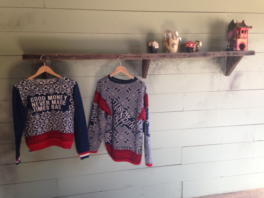 Installation view. Lisa Anne Auerbach sweaters (left). Image courtesy of Bianca Guillen.