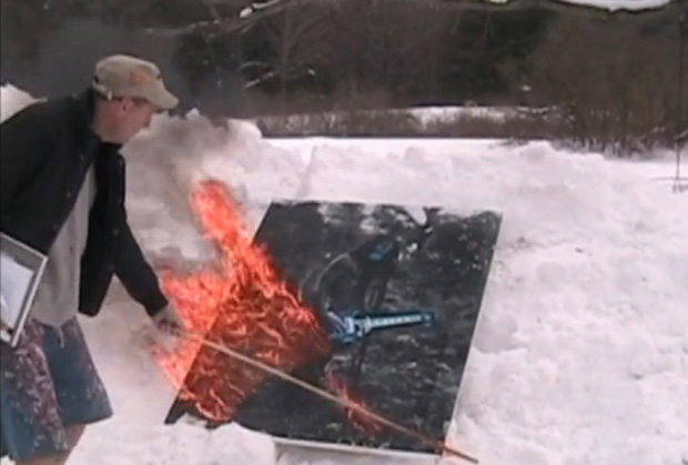 A screenshot from a video that originally appeared on the artist's personal Twitter account, allegedly showing him lighting one of the contested appropriation works on fire.