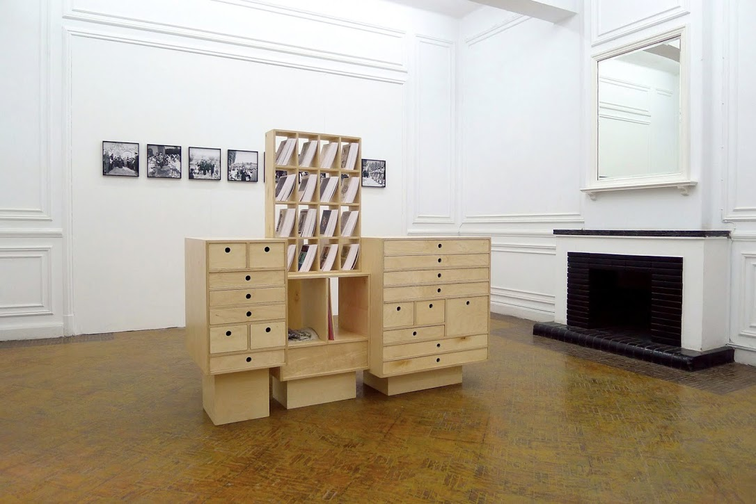 Rana Hamadeh, Al Karantina Installation view in The Magic of the State exhibition, Beirut in Cairo, 2013. Cabinet with various objects and original documents, 67 x 19 ½ x 63 inches. © the artist, courtesy of the artist
