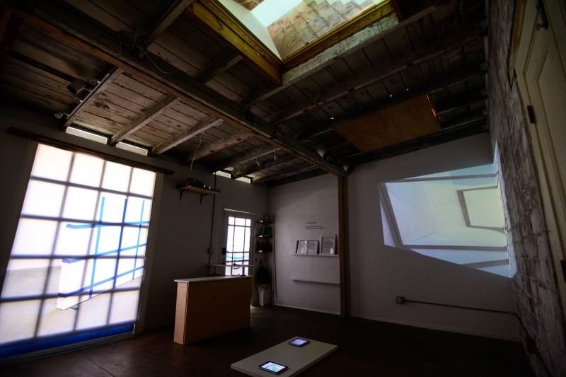 Installation view, clockwise from left: Cybele Lyle, Changing the Planes, 2014, Amy M. Ho, Up, 2014 (skylight), and Aaron Finnis, HCI, 2014 (floor)