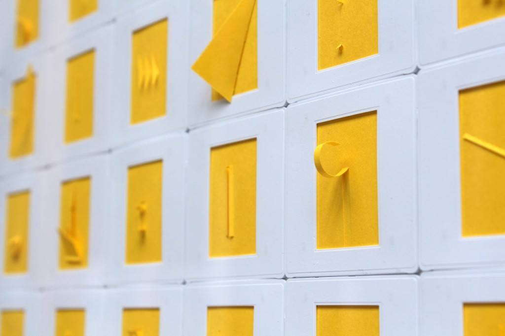 "Marco Maggi, ""Monochrome (Solar Yellow),"" 2014. Cuts and folds on 225 35mm papers in slide mounts (detail). Courtesy of Hosfelt Gallery."