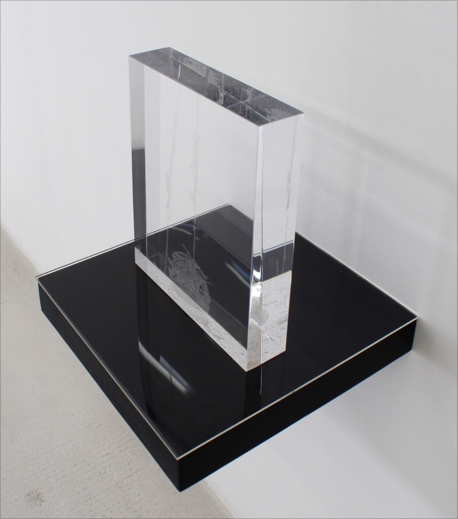 "Marco Maggi, ""Frozen Ream,"" 2014. Dry point on 11 in. x 8 1/2 in. x 2 in. Plexiglas block, on black shelf. Courtesy of Hosfelt Gallery."