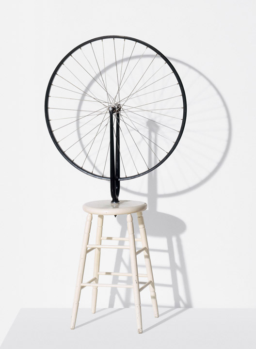 "Marcel Duchamp ""Bicycle Wheel"", 1916/64 Metal wheel mounted on painted wood stool, 51 x 25 x 16 inches / 129.5 x 63.5 x 40.6 cm. © Succession Marcel Duchamp / ADAGP, Paris / Artists Rights Society (ARS), New York 2014. Courtesy Gagosian Gallery. Photo by Philippe Migeat."