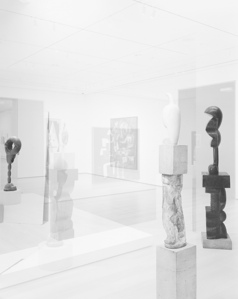 "Simon Starling, ""Pictures for an Exhibition,"" 2014. 20"" x 24"" silver gelatin print. Constantin Brancusi, ""Socrates"" (1922)  ""Maiastra"" (1910-12) and ""Adam & Eve"" (1916-21) (from left to right). Collections: Museum of Modern Art, New York, The Guggenheim Museum, New York. Courtesy of the artist, Casey Kaplan Gallery and Artist Rights Society."
