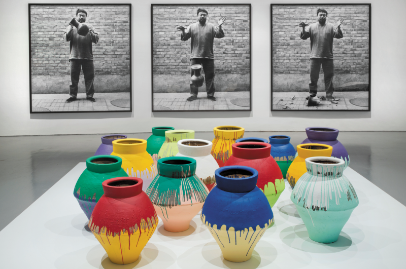 """Ai Weiwei, """"Colored Vases,"""" 2007‒10. Han Dynasty vases and industrial paint, dimensions variable. Courtesy of Ai Weiwei Studio. Installation view of Ai Weiwei: According to What? at the Hirshhorn Museum and Sculpture Garden, Washington D.C., 2012. Photograph by Cathy Carver."""