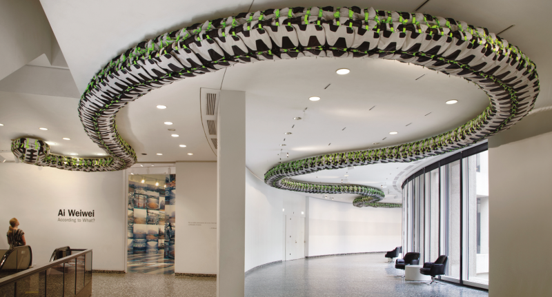 """Ai Weiwei, """"Snake Ceiling,"""" 2009. Back packs, 15 3/4 x 354 5/16 in. (40 x 900 cm). Collection of Larry Warsh. Installation view of Ai Weiwei: According to What? at the Hirshhorn Museum and Sculpture Garden, Washington D.C., 2012. Photo by Cathy Carver."""