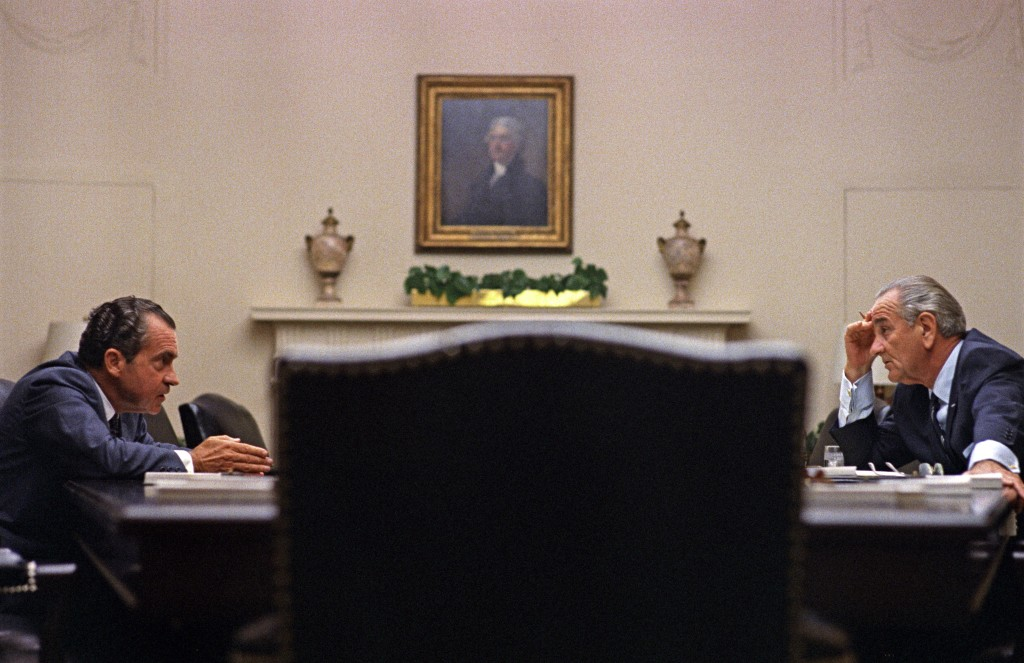 Lyndon B. Johnson and Richard Nixon meet in 1968.