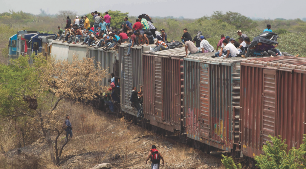Central American migrants risk life and limb riding freight train wagons to reach the U.S. Courtesy of the Internet.