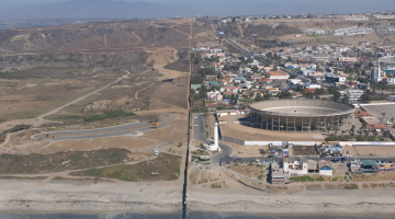 "The western-most United States [left] / Mexico [right] border. ""Friendship Park"" is a parking lot on the left. The physical border extends into the ocean."