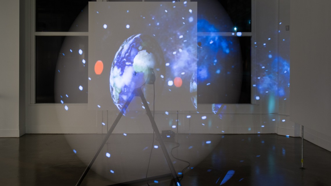 "Eva Schlegel, ""Rotor Universe,"" 2014. Rotor, video projection. 94 inches (240 cm) diameter; 300 rpm (Running time 5 minutes, 20 seconds) Installation photos Johnna Arnold. Courtesy of Eve Schlegel and Gallery Wendi Norris."