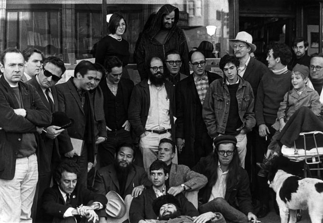 The Last Gathering of the Beats. City Lights Books, 1965. Front Row (Left to right): LaVigne, Murao, Fagin, Meyezove (lying down), Welch, Orlovsky, Homer. Second Row: Meltzer, McClure, Ginsberg, Langton, Steve, Brautigan, Goodrow, Frost. Back Row: Levy, Ferlinghetti.