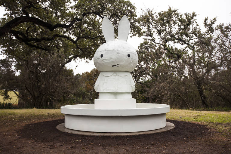 "Tom Sachs, Miffy Fountain, 2008. Silicon bronze and paint (3-part catalyzed acrylic, white primer, white base coat, ""Xtreme"" Flat Finish Klearkote). 111 x 102 x 102 inches. Installation view, The Contemporary Austin – Betty and Edward Marcus Sculpture Park at Laguna Gloria, Austin, 2015. Photograph by Brian Fitzsimmons. Courtesy Tom Sachs Studio and the Contemporary Austin."