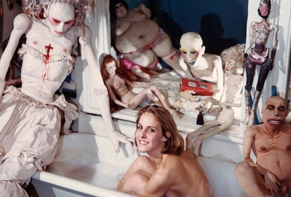 Eric Kroll, Greer Lankton Surrounded by her Sculpture, 1984. C-print, 19 1/2 x 15 1/2 inches.