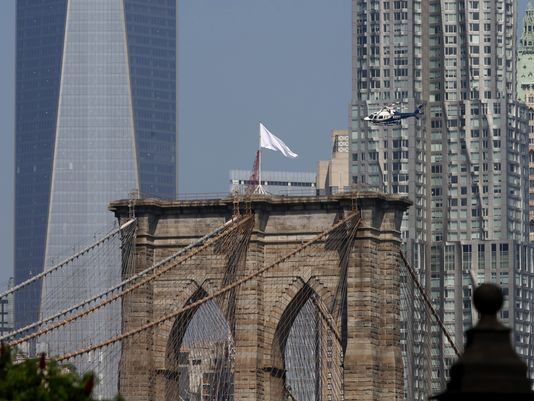 White Flags on top the Brooklyn Bridge, New York City, 2014. Photo by Andrew Gombert, European Pressphoto Agency.
