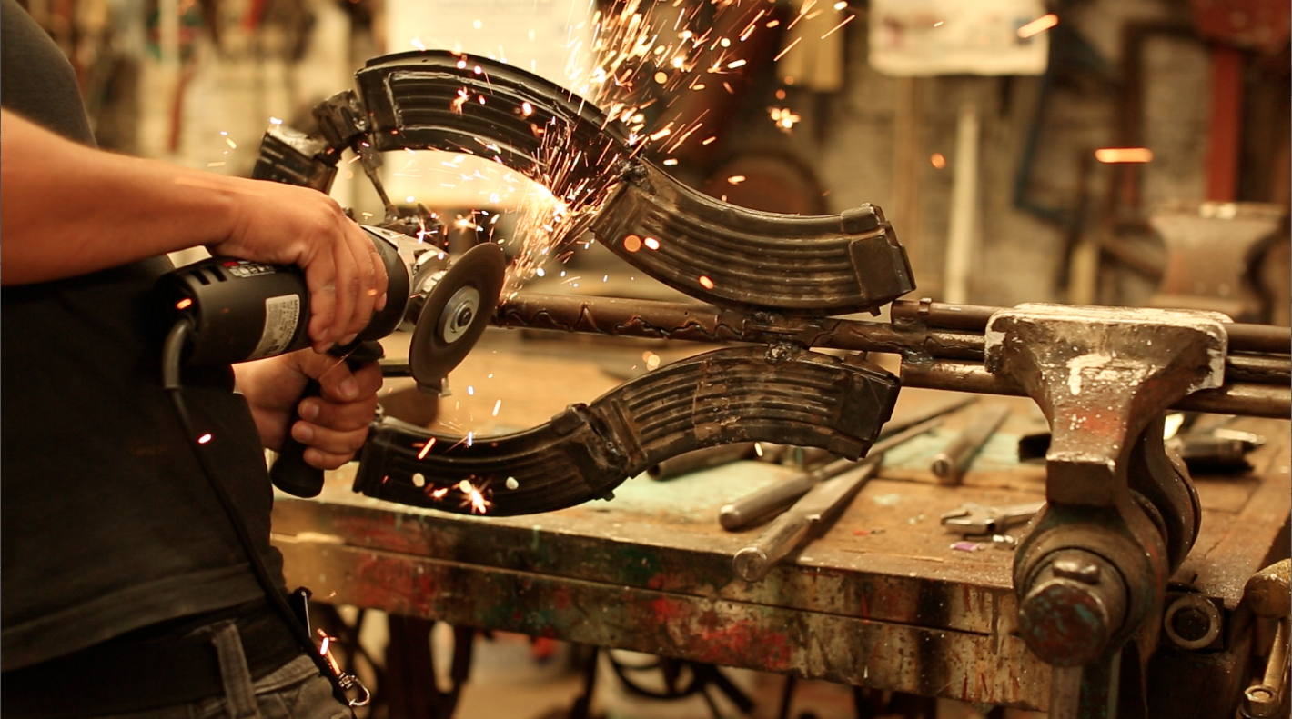 Imagine, 2012. Documentation of fabricating a musical instrument out of a destroyed weapon. Courtesy of the artist.
