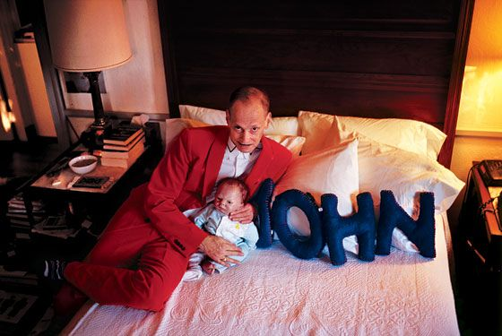 John Waters photographed with his fake child, Bill. Photo by Nan Goldin.