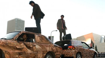Eamon Ore-Giron and Chris Avitabile atop cars at the beginning of an OJO performance, Flesh Car Crash, 2008. MOCA, Los Angeles. Courtesy of the artist and MOCA, Los Angeles.
