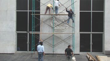 Dismantlement and Reinstallation of the National Coat of Arms, 2008. Intervention. Courtesy of the artists.