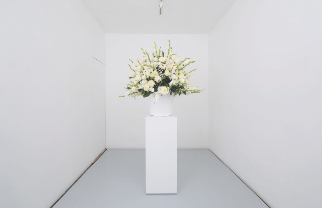 "Willem de Rooij, ""Bouquet IX,"" 2012. White ceramic vase, plinth, 10 different sorts of flowers. Photograph by Guillermo Soto. Courtesy Daniel Buchholz Galerie, Cologne and Berlin, and Lulu, Mexico City."