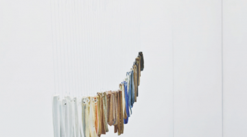 "Kate Newby, ""I feel like a truck on a wet highway,"" 2014. String, thread, ceramic wind chimes (high fired porcelain, stoneware, glaze), paint. Photograph by Isaac Contreras. Courtesy of Lulu, Mexico City."