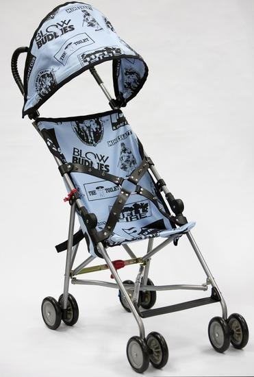 "John Waters, ""Bill's Stroller,"" 2014. Umbrella lightweight stroller with silkscreened linen and spiked, leather belt. 39 x 14 x 26 inches. Courtesy of the artist and Marianne Boesky Gallery."
