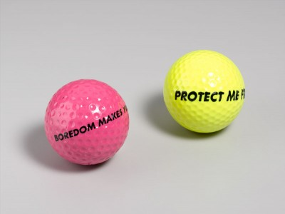 Jenny Holzer, Boredom/Protect golf balls, 1992. Ink on golf ball, 1.75 inches in diameter each. Photo © Lloyd Hryciw. Courtesy of Gregory Lind Gallery.