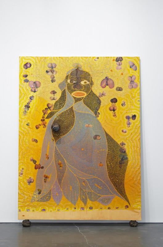 Chris Ofili, The Holy Virgin Mary, 1996. Paper collage, oil paint, glitter, polyester resin, map pins and elephant dung on linen, 96 by 72 inches. Courtesy of the artist and New Museum. Photo by Benoit Pailley.