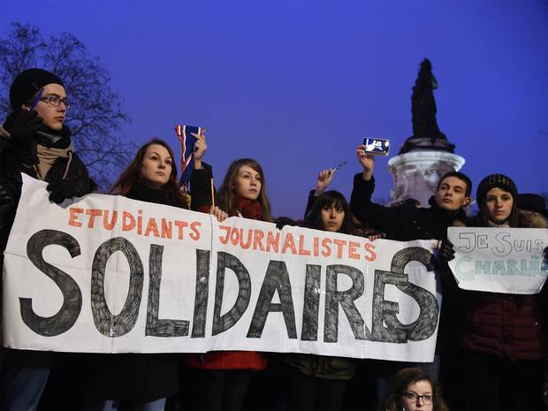 Students attend the masses holding a vigil at Place de la République in Paris on 07 January 2015. Image courtesy The Independent.