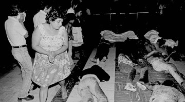 The dead, shot by federal soldiers, are laid out on the sanctuary floor of the San Salvador Metro Cathedral after they were dragged inside the sanctuary from the steps of the church where they were shot.