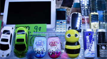 A collection of Shanzhai phones being sold in an underground market in Guilin, China. Courtesy of Ben Valentine.