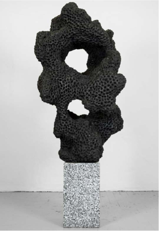 Napalm Stone (Graphite Version #1), 2014. Napalm, play-dough, powdered graphite, terrazzo. 67 x 30 x 22 in. Image Courtesy of Gallery Wendi Norris, San Francisco.