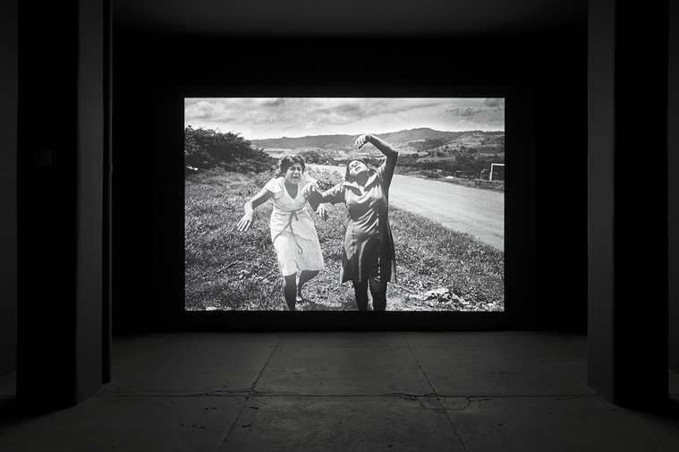 "Alfredo Jaar. ""Shadows"" Installation View, installation with LED lights, aluminum, video projection, 116 x 174 inches. Original photograph by Koen Wessing (1942-2011): Estelí, Nicaragua, September 1978. Courtesy: Galerie Lelong, New York; © Netherlands Fotomuseum, Rotterdam, 2015."