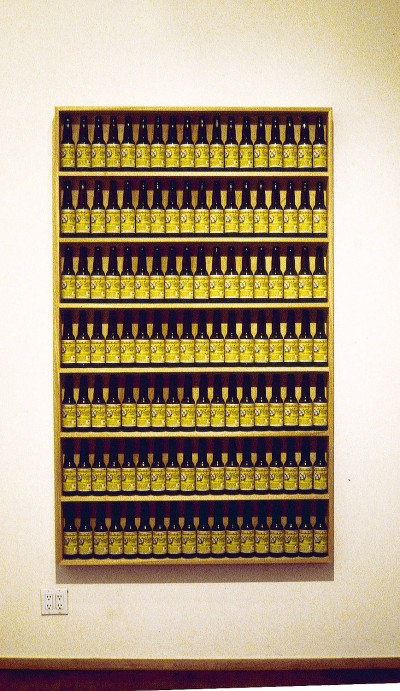 Tom Marioni, Golden Rectangle, 2000. 7 shelves of Pacifico beer bottles, 80 x 51 x 8 inches.