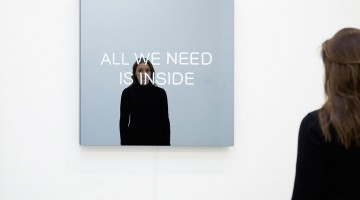 Jeppe Hein, ALL WE NEED IS INSIDE, 2014. Powder-coated aluminum, neon tubes, two-way mirror, powder-coated steel, transformers, edition of 3. 39.5 x 39.5 x 4.25 inches. Courtesy of 303 Gallery.