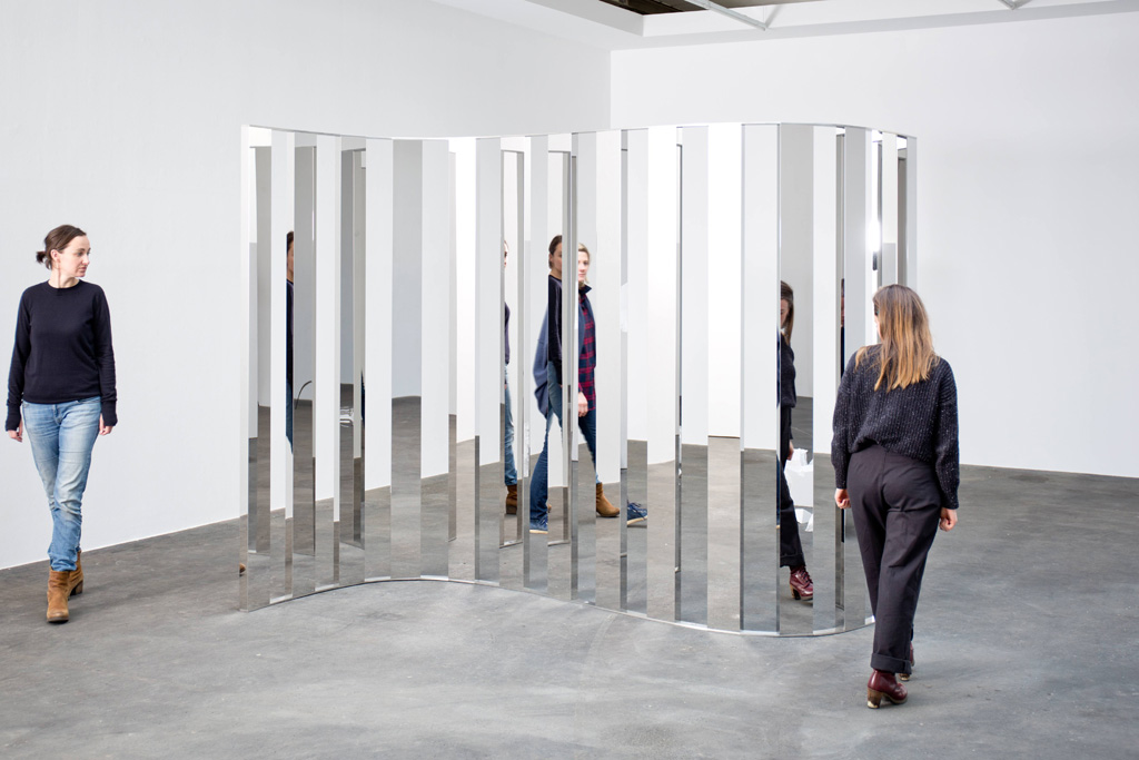 Jeppe Hein, Sine Curve I, 2015. High polished stainless steel, aluminum, edition of 3. 86 2/3 x 126 x 52 3/4 inches. Courtesy of 303 Gallery.
