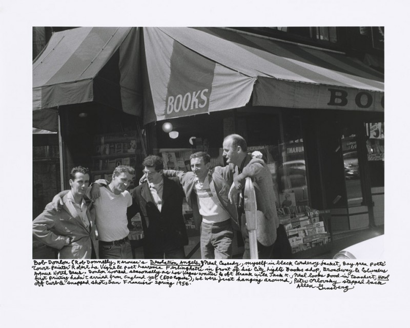 "Bob Donlon (Rob Donnelly, Kerouac's Desolation Angels), Neal Cassady, myself in black corduroy jacket, Bay Area poets' ""Court Painter"" Robert La Vigne & poet Lawrence Ferlinghetti in front of his City Lights Books shop, Broadway & Columbus Avenue North Beach. Donlon worked seasonally as Las Vegas waiter & oft drank with Jack K., Neal looks good in tee shirt, Howl first printing hadn't arrived from England yet (500 copies), we were just hanging around, Peter Orlovsky stepped back off curb & snapped shot, San Francisco spring 1956."