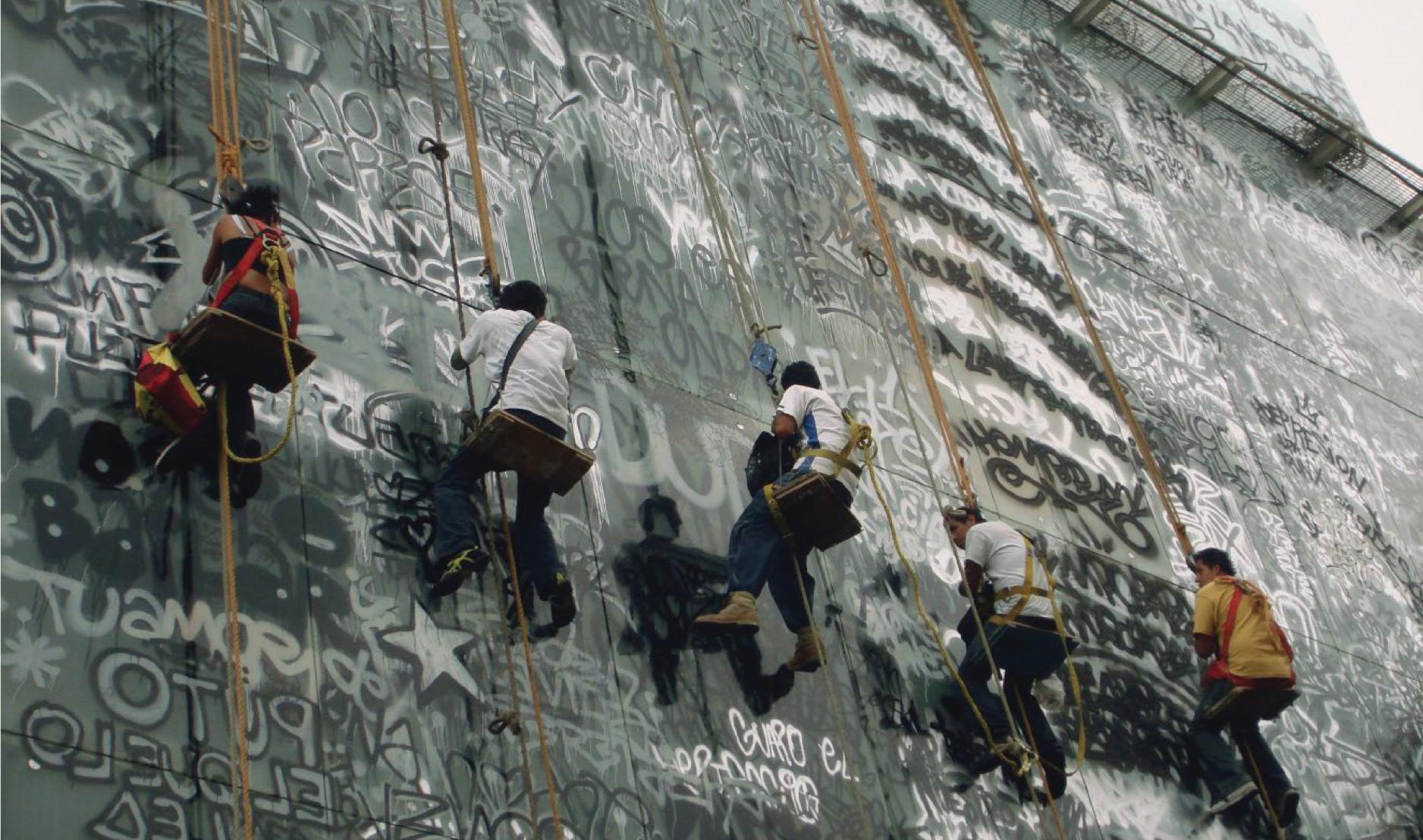 Tania Candiani, Habita Intervenido, 2008. Stencil and spray paint on glass. Hotel Habita, Mexico City. Courtesy of the artist.