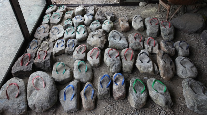"UNITED ARAB EMIRATES:   Abdullah Al Saadi creates stone slippers as retirement gifts for the Bush family.  ""I'm thinking stone-drones (or, STRONES) for the Obamas"", Saadi reported."