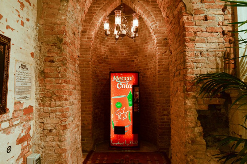 "ICELAND:  Included in Christoph Büchel's ""The Mosque"" (which was shut down by local police on Friday) is a Mecca Cola vending machine, where you can grab a refreshing beverage as you repress the urge to draw depictions of the Profit Mohammad in private."