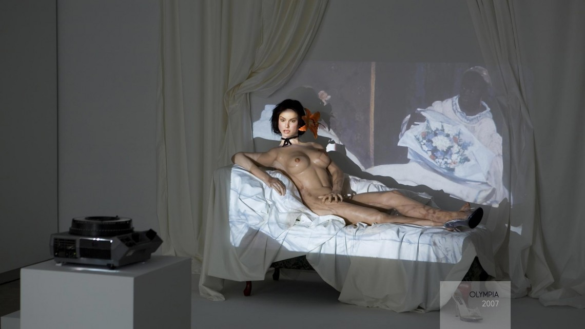 Lynn Hershman Leeson, Olympia, 2007. Custom life-size sex doll, chaise lounge, sheets, scrims, and slides. Courtesy of the artist.