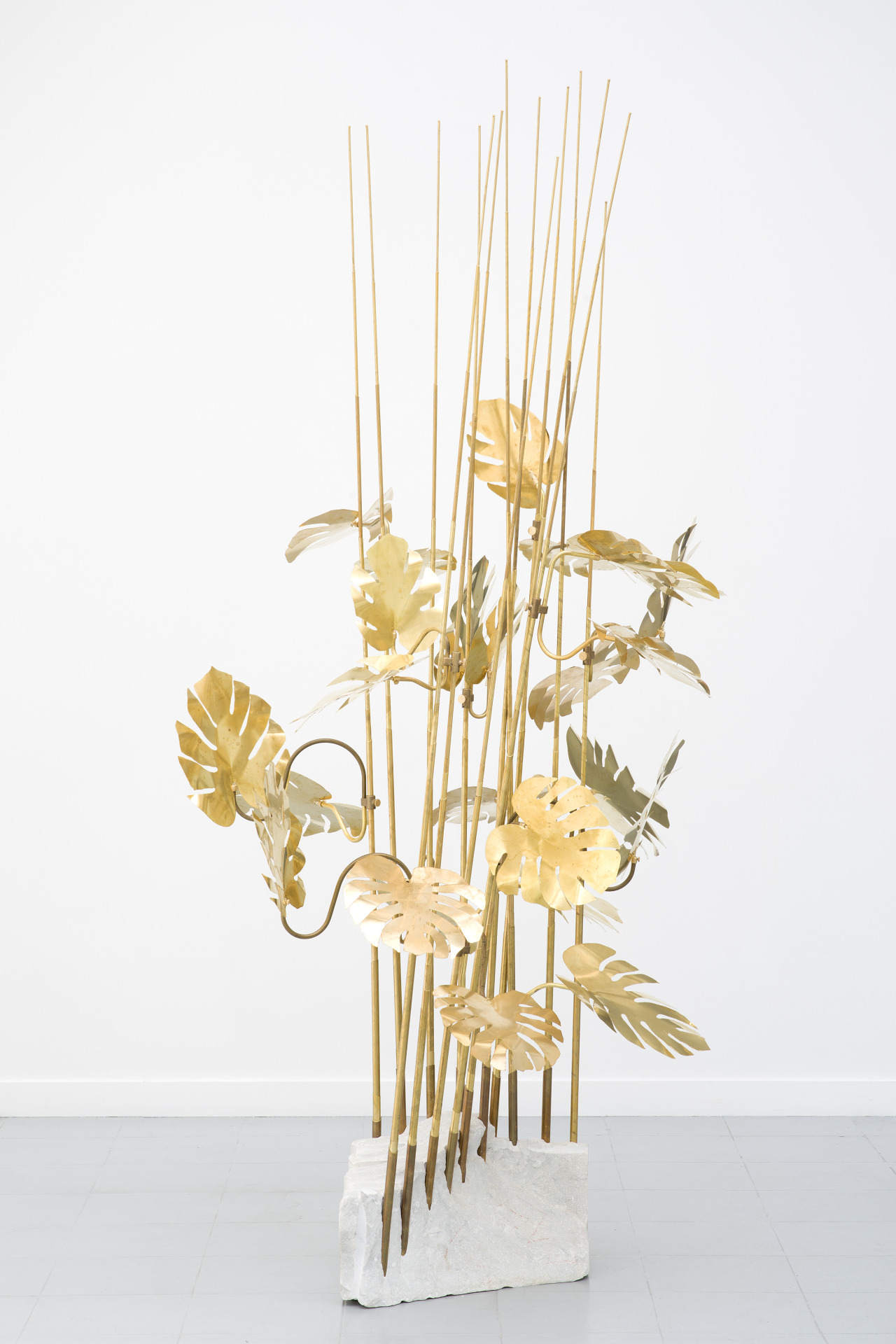 Sharp points lower the required voltage, electric fields are more concentrated in areas of high curvature, phenomena more intense at ends of pointed objects, 2014. Brass, marble. Dimensions variable. Courtesy of the artist.