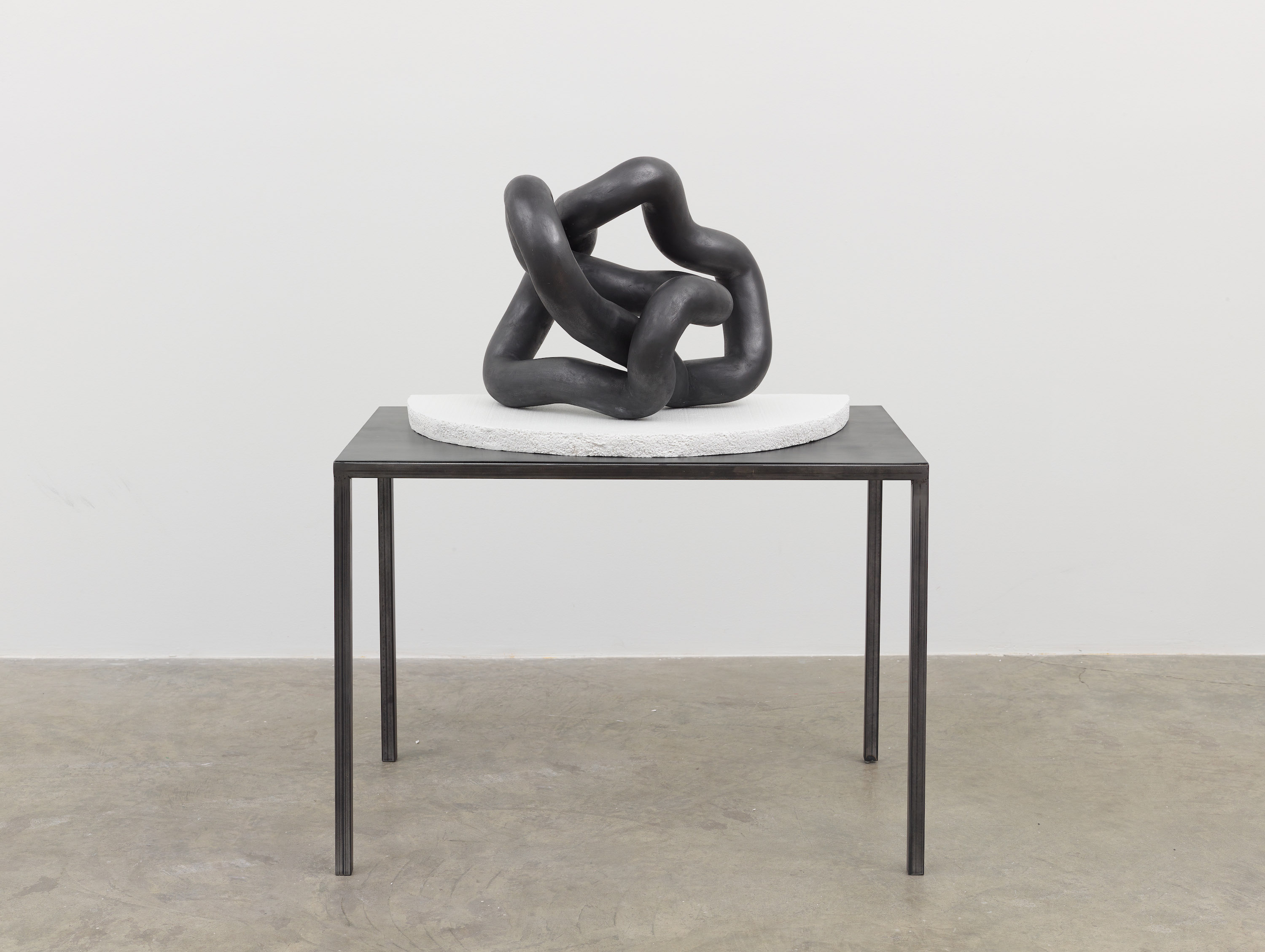Carolyn Salas, Movement Studies (No. 3), 2015. Cast Hydrocal, graphite powder, sealant on metal base. 46 x 26 x 22.5 inches. Courtesy of Koenig & Clinton.