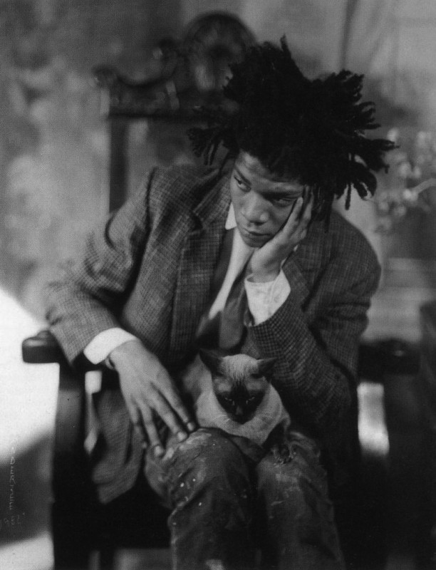 Jean-Michel Basquiat with his cat shortly before trading her for anti-depressants.