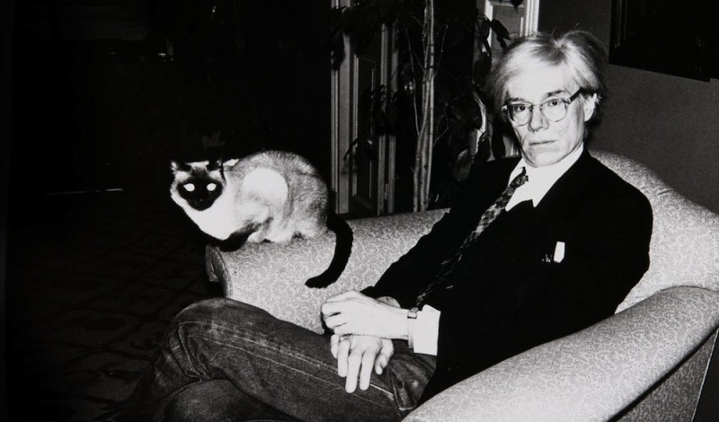 Andy Warhol with Sam, his cat and only lover.