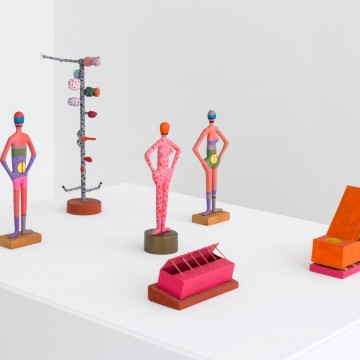 Sculptures by Jeremy Anderson (Untitled Figure, 1960s. 14 x 5 x 2.5 inches;  Untitled, 1960s. 18.5 x 8.5 x 4 inches; Untitled Figure, 1960s. 13 x 3.5 x 5.25 inches; Untitled Figure, 1960s. 13.25 x 6.5 x 2.25 inches; Poor Soul, 1978. 3.74 x 8.125 x 3.5 inches; Soul of a Super Stud, 1978. Cardboard and mixed media. 7.625 x 8.25 x 3.625 inches. Courtesy of Matthew Marks Gallery.
