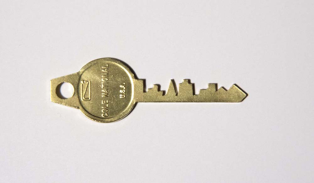 "Alice Shaw. ""Key To The City - San Francisco,"" 2014. Brass, 1"" x 2.5"""
